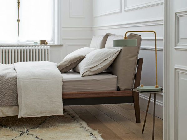 bed with upholstered cushions