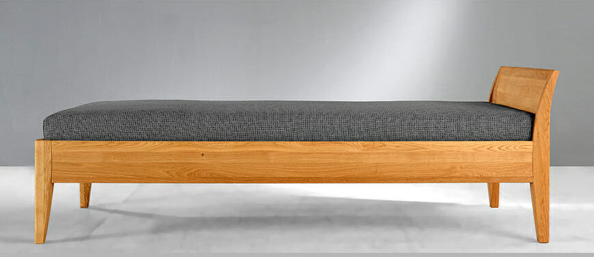 Bed with low backrest